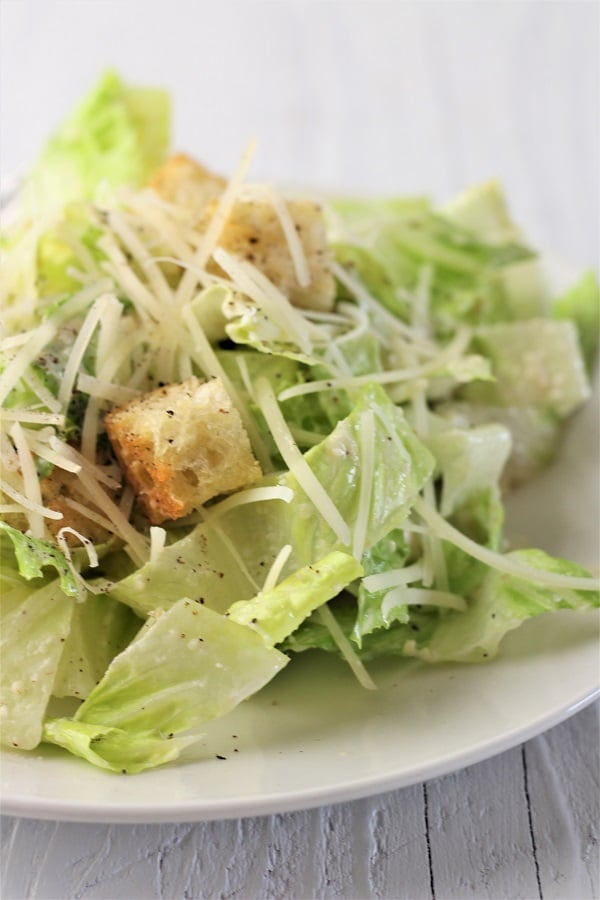caesar salad on a white plate