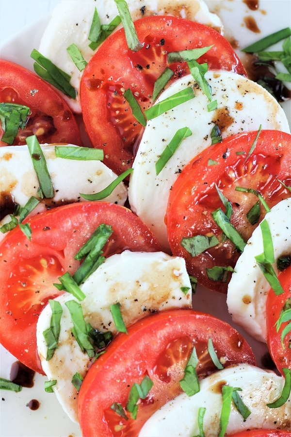 close up of caprese salad with balsamic drizzle