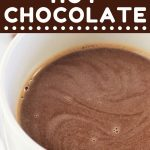mug of hot chocolate with a text overlay that says now cook this chocolate chip hot chocolate