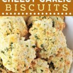 cheesy garlic biscuits on a white plate with a text overlay that says now cook this easy cheesy garlic biscuits