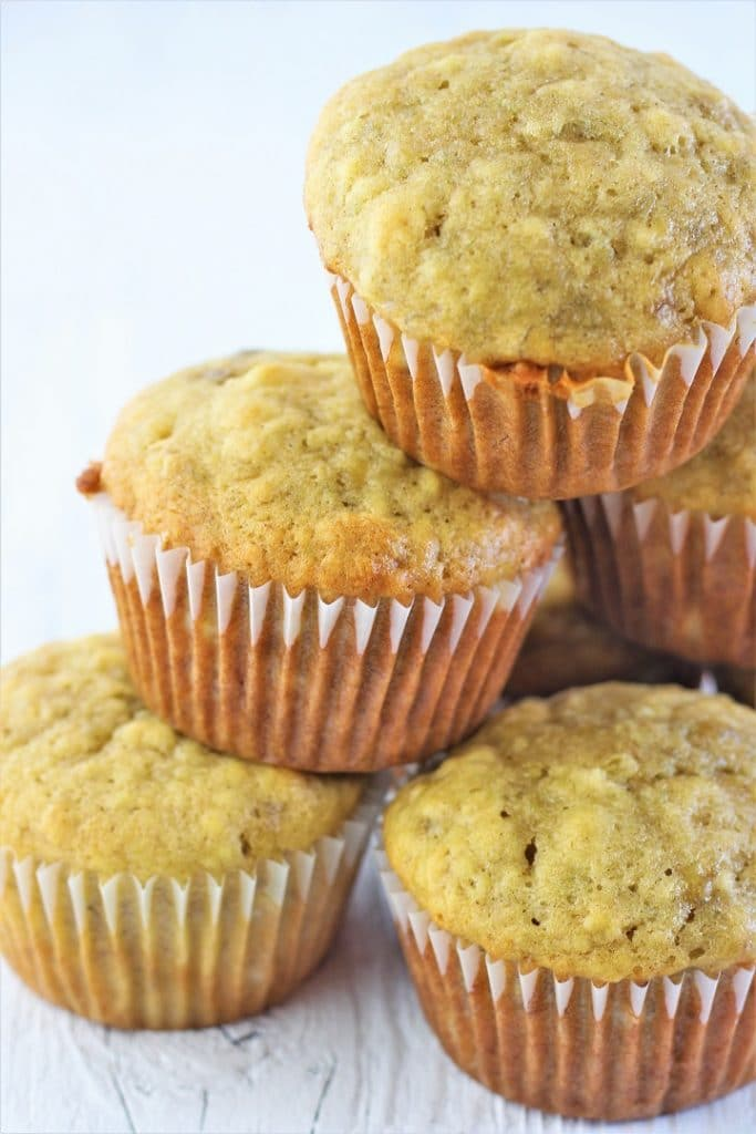 banana bread muffins stacked in a pile