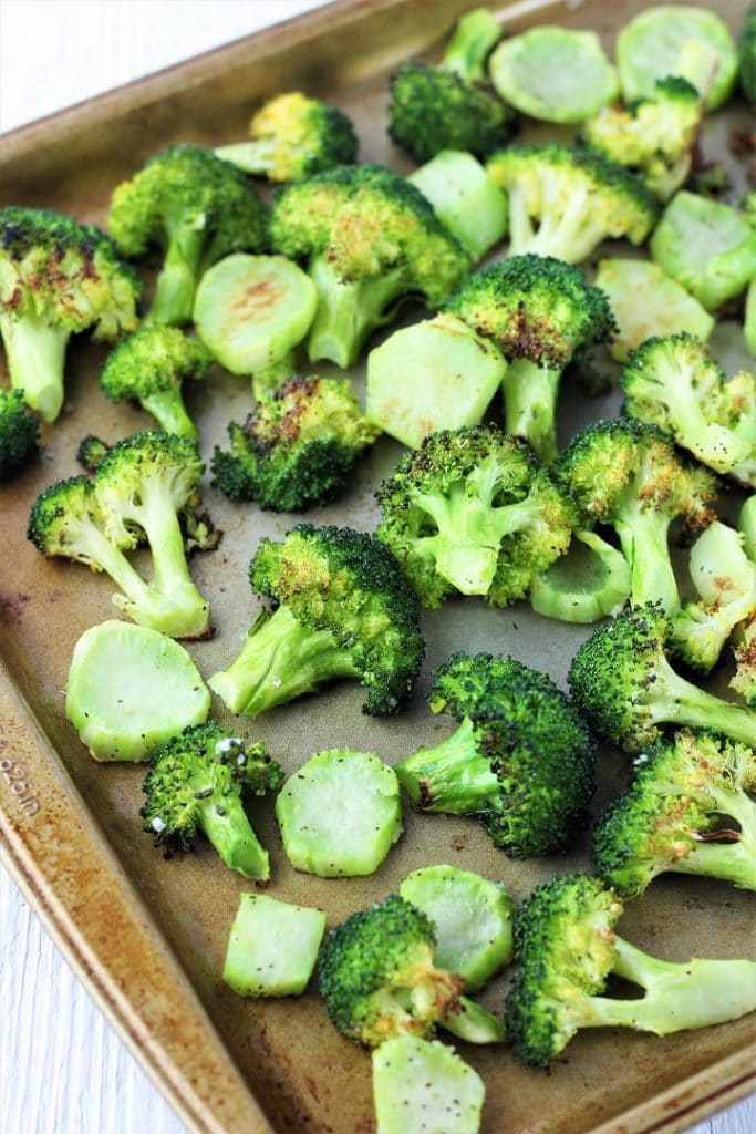 oven roasted broccoli on a baking sheet