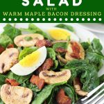 plate of spinach salad with a text overlay that says now cook this spinach salad with warm maple bacon dressing