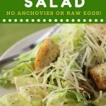 plate of caesar salad with a text overlay that says now cook this caesar salad no anchovies or raw eggs