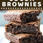 stack of brownies with a text overlay that says now cook this easy homemade cocoa brownies
