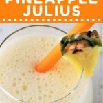 glass of pineapple julius with a straw with a text overlay that says now cook this homemade pineapple julius