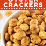 bowl of oyster crackers with a text overlay that says now cook this cajun spiced oyster crackers