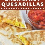 3 quesadilla wedges on a white plate with a small bowl of salsa with a text overlay that says now cook this easy breakfast quesadillas