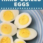 halved hard boiled eggs on a blue plate with a text overlay that says now cook this instant pot hard boiled eggs