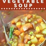 ladle of vegetable soup being taken from a pot with a text overlay that says now cook this spicy tomato vegetable soup