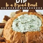 dip in a bread bowl with a text overlay that says now cook this spinach dip in a bread bowl