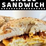 bagel sandwich cut in half with a text overlay that says now cook this breakfast bagel sandwich