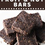 pile of fruit and nut bars with a text overlay that says now cook this chocolate brownie fruit and nut bars