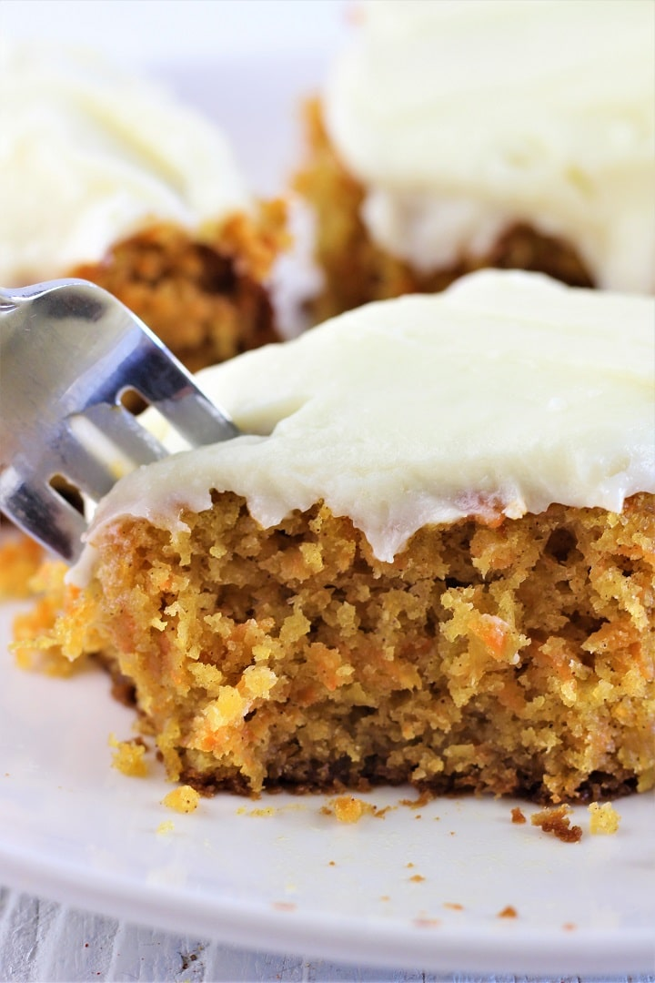 piece of carrot cake with a fork taking a piece out