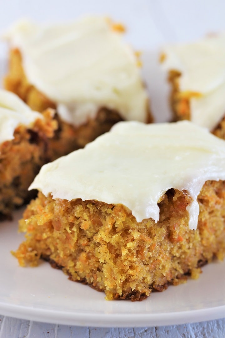 several pieces of carrot cake on a white plate