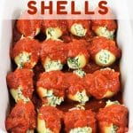 baking dish filled with stuffed shells with a text overlay that says spinach and cheese stuffed shells nowcookthis.com
