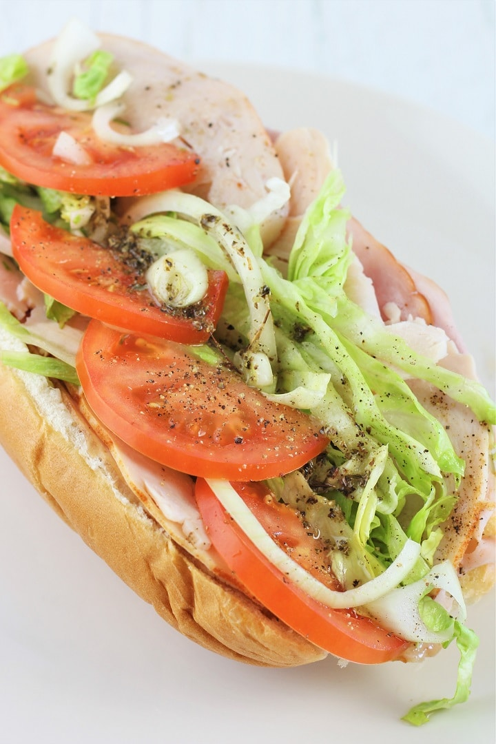turkey italian hoagie on a white plate
