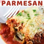 piece of eggplant parmesan and sauce on a white plate with a fork and red napkin with a text overlay that says baked eggplant parmesan nowcookthis.com