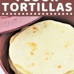 tortillas in a tortilla warmer with a text overlay that says now cook this easy homemade flour tortillas