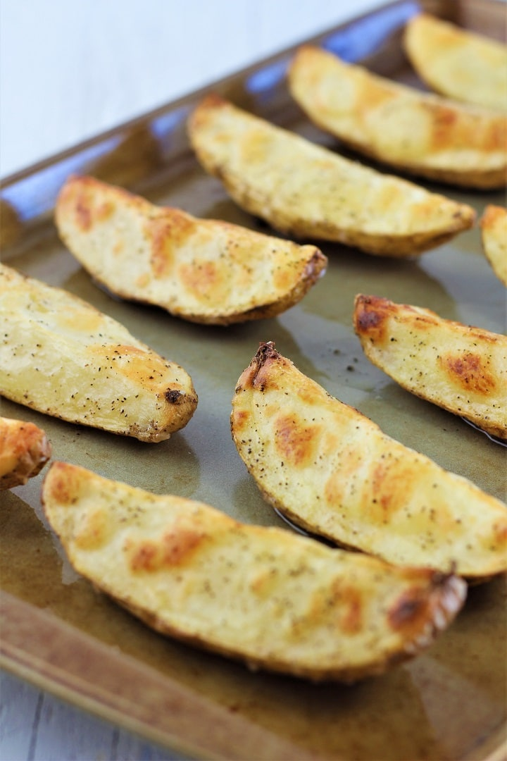 oven roasted potato wedges on a baking sheet