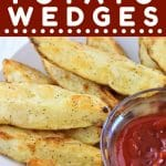 roasted potato wedges and a small bowl of ketchup with a text overlay that says now cook this oven roasted potato wedges