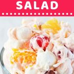 ambrosia salad in a dessert bowl with a text overlay that says now cook this ambrosia salad