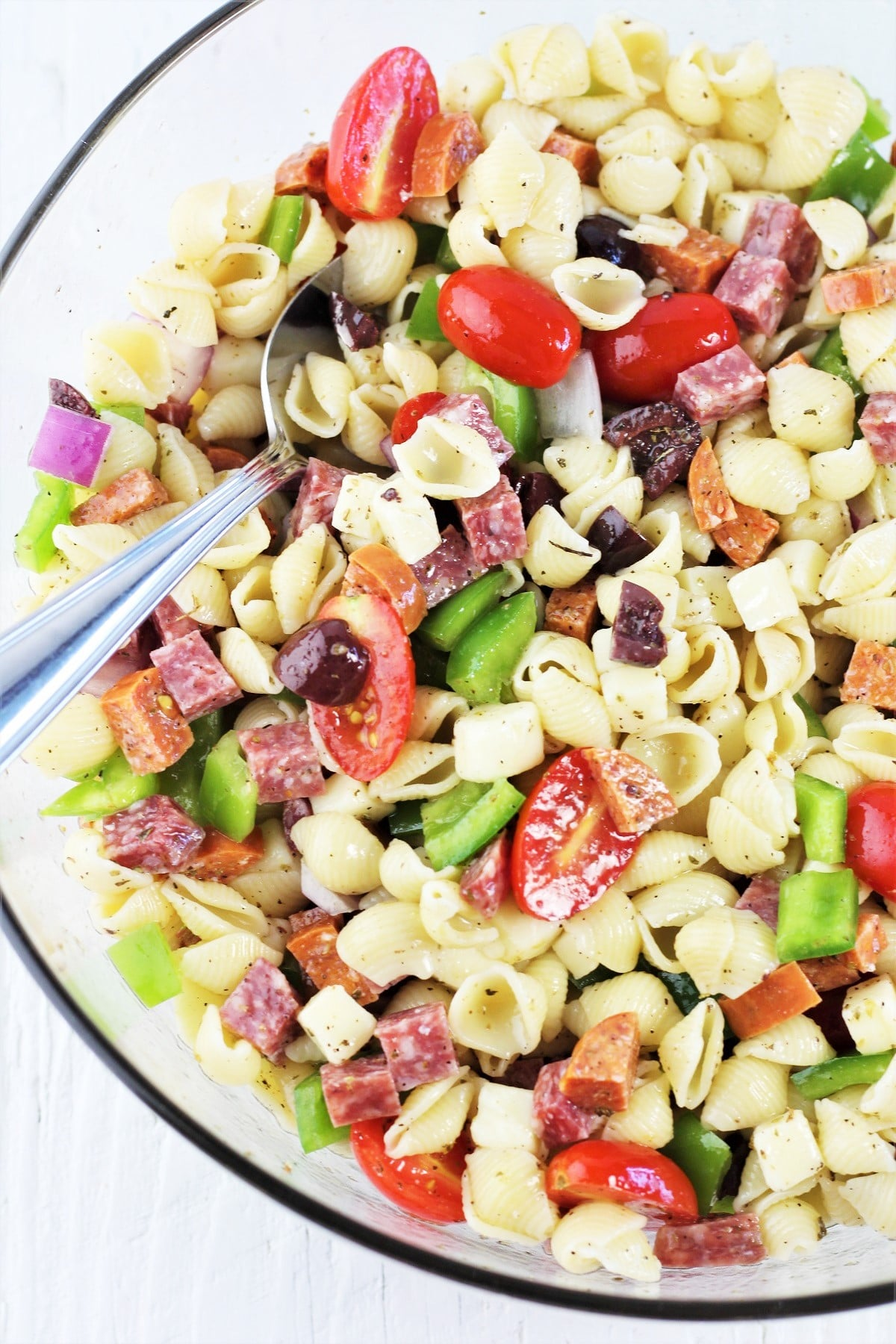 large bowl of pasta salad with a serving spoon