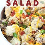 bowl of potato salad with a text overlay that says cheesy bacon ranch potato salad nowcookthis.com