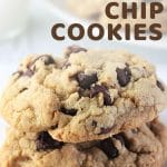 two cookies stacked on a plate with a text overlay that says now cook this big, thick, bakery-style chocolate chip cookies