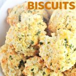 cheesy garlic biscuits on a plate with a text overlay that says now cook this easy cheesy garlic biscuits