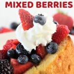 pound cake topped with berries and whipped cream with a text overlay that says now cook this pound cake with marsala mixed berries