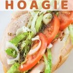 hoagie on a plate with a text overlay that says turkey italian hoagie nowcookthis.com