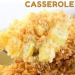 spoonful of yellow squash casserole being scooped out of the pan with a text overlay that says now cook this cheesy yellow squash casserole