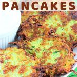 zucchini potato pancakes on a plate with a side of sour cream with a text overlay that says zucchini potato pancakes nowcookthis.com