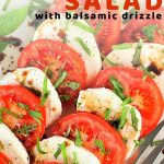 caprese salad on a plate with a fork with a text overlay that says now cook this caprese salad with balsamic drizzle