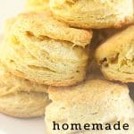 pile of biscuits with a text overlay that says now cook this homemade buttermilk biscuits