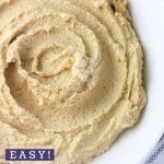 bowl of hummus with a text overlay that says now cook this easy homemade hummus