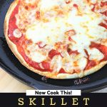 tortilla pizza in a cast iron skillet with a text overlay that says now cook this skillet tortilla pizza