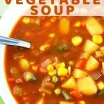 bowl of vegetable soup with a text overlay that says spicy vegetable soup nowcookthis.com