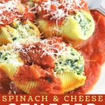 stuffed shells on a plate with a fork with a text overlay that says now cook this spinach and cheese stuffed shells