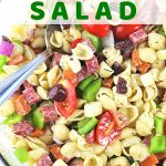 pasta salad in a bowl with a text overlay that says antipasto pasta salad nowcookthis.com