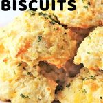 biscuits on a plate with a text overlay that says easy cheesy garlic biscuits nowcookthis.com