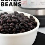 bowl of black beans with a text overlay that says now cook this instant pot black beans