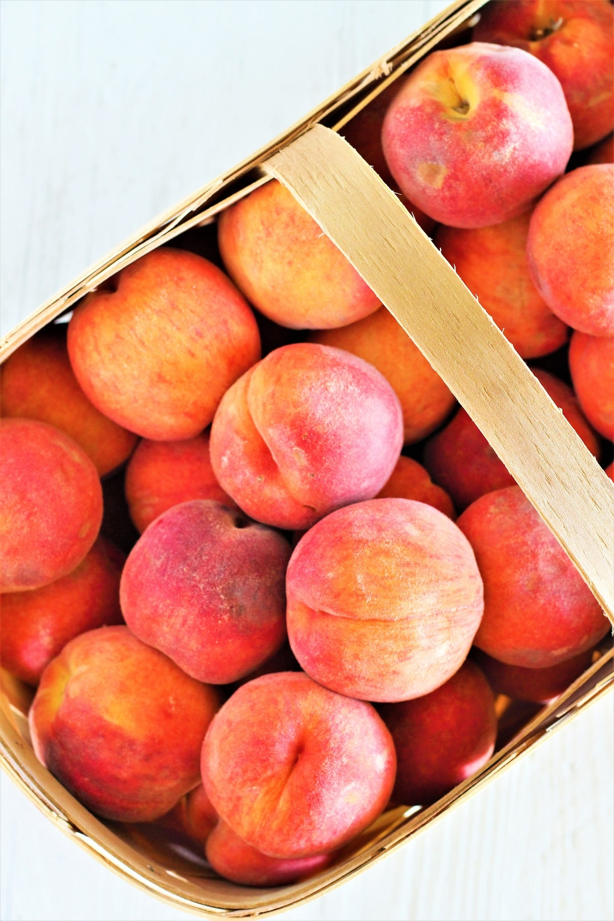 large basket of fresh peaches