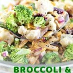 bowl of salad with a spoonful being taken out with a text overlay that says now cook this broccoli and cauliflower salad