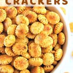 bowl of oyster crackers with a text overlay that says cajun spiced oyster crackers nowcookthis.com
