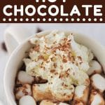 mug of hot chocolate with marshmallows and whipped cream with a text overlay that says now cook this chocolate chip hot chocolate
