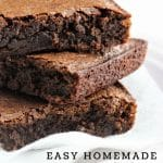 stacked brownies on a napkin with a text overlay that says now cook this easy homemade cocoa brownies