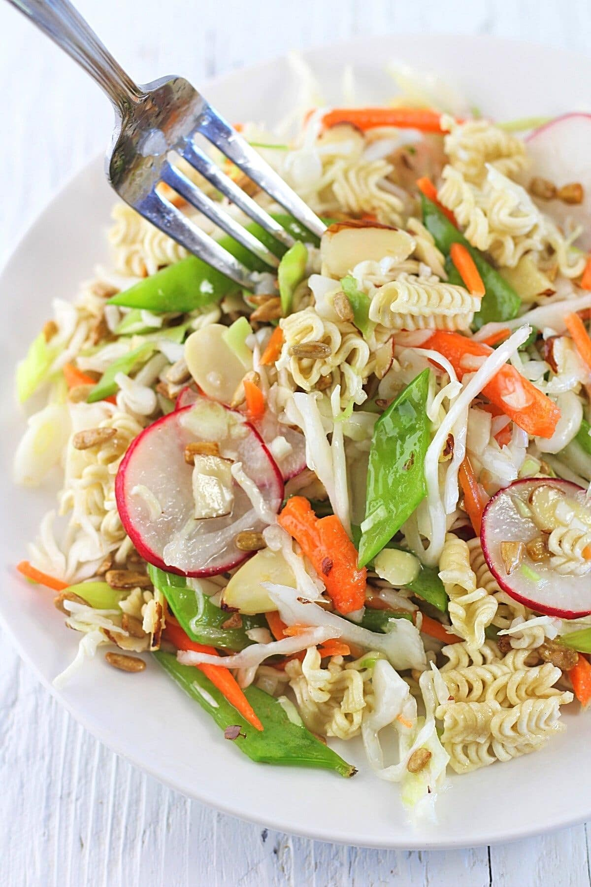 ramen noodle salad on a plate with a fork