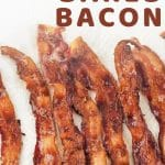 bacon on a plate with a text overlay that says now cook this (the best way to cook bacon) baked bacon